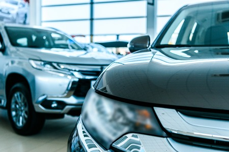 Cropped image of New cars in car showroom Stock Photo