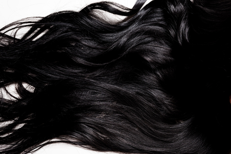 beautiful glossy brunette hair isolated on white