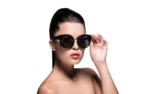 attractive woman in stylish sunglasses with red lips isolated on white