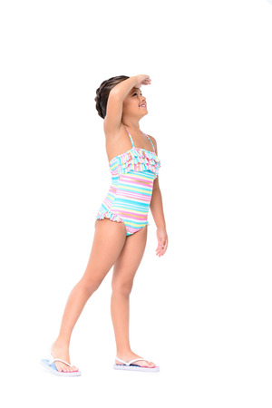 adorable little girl in swimsuit looking away isolated on white