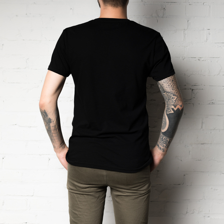 cropped shot of man in blank black t-shirt Stock Photo