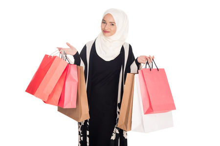 beautiful muslim woman with shopping bags isolated on white