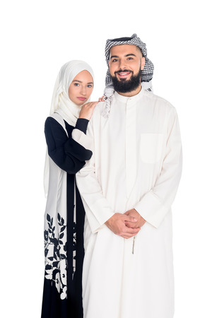 attractive muslim couple in traditional clothing isolated on white Imagens