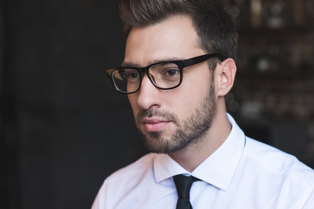 Portrait shot of young handsome businessman in white shirt and tie
