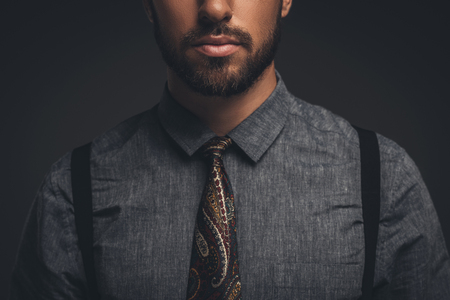 Cropped shot of young bearded man wearing shirt and tie