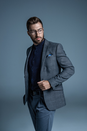Young handsome businessman in formal suit and glasses  Imagens