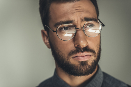 Portrait shot of young handsome man in glasses