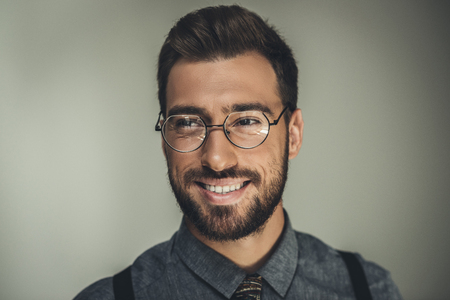Portrait shot of young smiling man in glasses Imagens