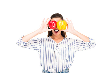 obscured view of woman covering eyes with tasty peppers isolated on white Stock Photo