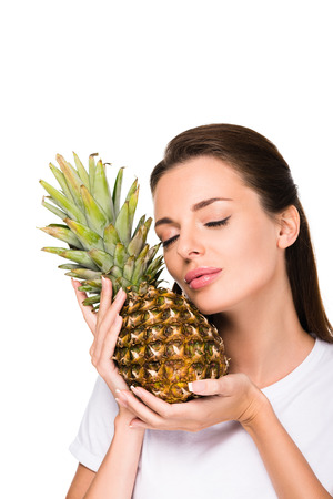 portrait of woman with fresh pineapple isolated on white Stockfoto