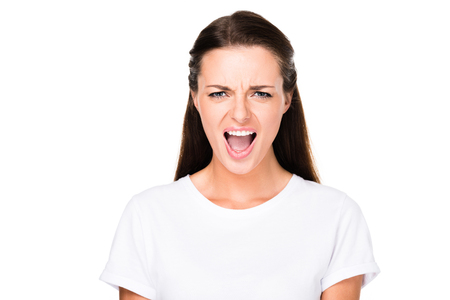 portrait of young woman screaming while looking at camera isolated on white Banco de Imagens