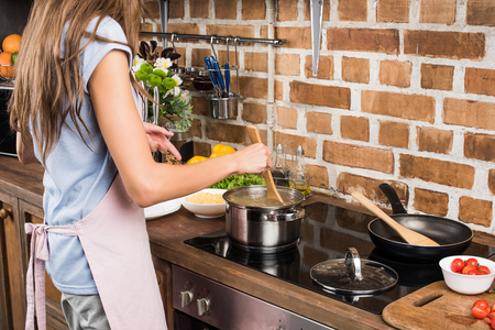partial view of woman preparing pepper for dinner in kitchen at home Stock Photo