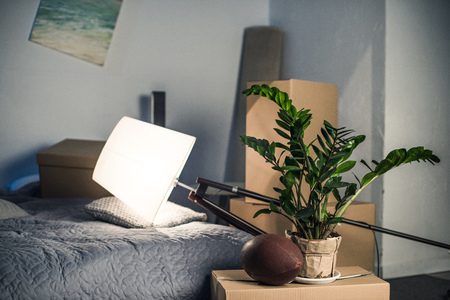 close up view of decorative floor lamp on bed