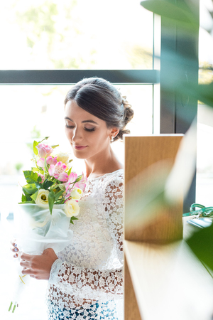 portrait of beautiful smiling woman with bouquet of flowers Stok Fotoğraf
