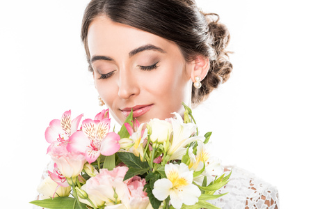portrait of sensual woman with eyes closed and bouquet of flowers isolated on white