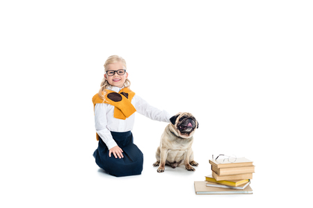 cute happy little girl in eyeglasses stroking dog isolated on white