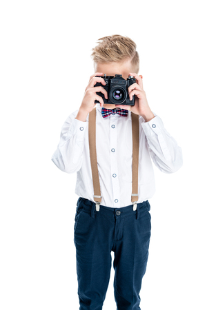 stylish little photographer using camera isolated on white Stock Photo - 102341560
