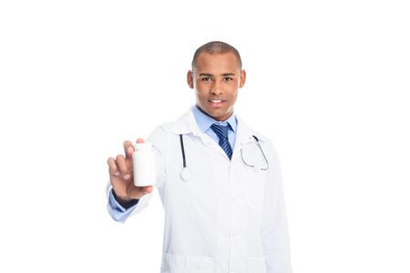 african american male doctor in white coat with pill bottle, isolated on white