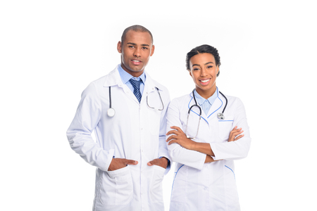 african american doctors in white coats with stethoscopes, isolated on white Stock fotó