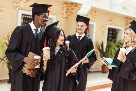 group of graduated multiethnic students spending time together