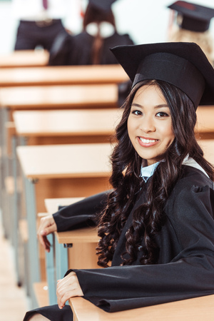 graduated asian student girl sitting at class Stockfoto