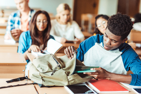 group of young multiethic students sitting in class Stock Photo
