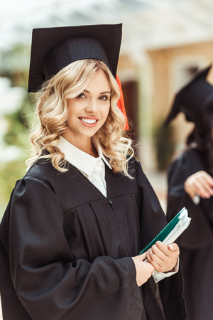 beautiful young graduated student girl with notebook Stockfoto