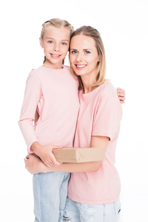 cheerful daughter and mother hugging isolated on white