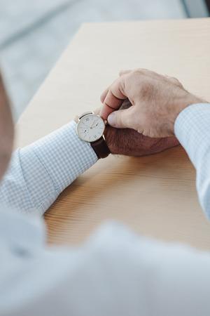 cropped shot of businessman setting watch Stock Photo
