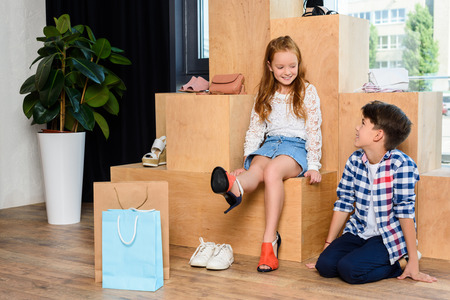 happy little couple on shopping in shoe store 스톡 콘텐츠 - 102322693