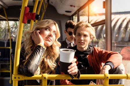 portrait of young people riding in public transport