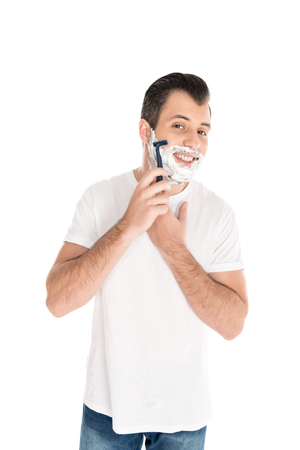 bearded man shaving with razor, isolated on white Stock Photo