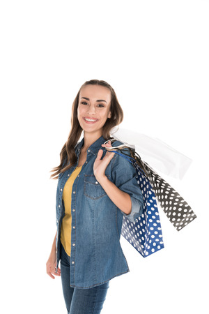 beautiful woman with shopping bags, isolated on white