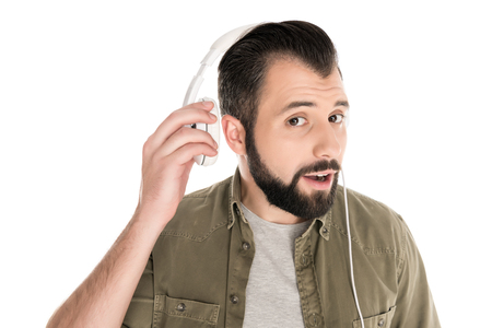bearded man listening music with headphones, isolated on white