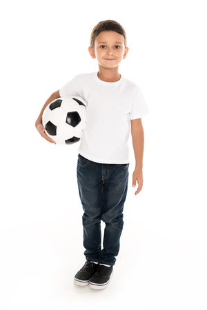 little boy holding soccer ball, isolated on white