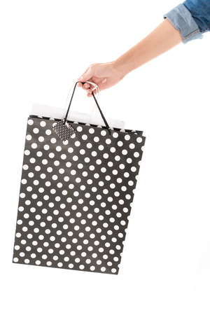 cropped view of woman with shopping bags, isolated on white