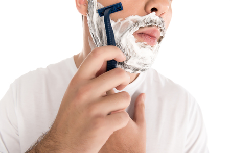 cropped view of bearded man shaving with razor, isolated on white 스톡 콘텐츠