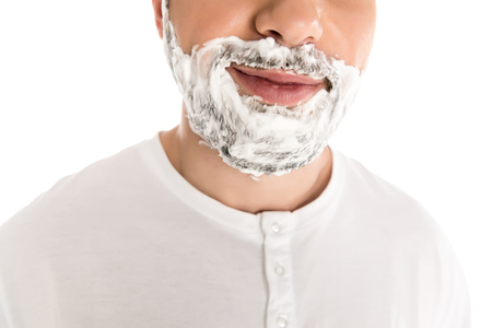 cropped view of bearded man in shaving foam, isolated on white
