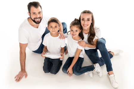 high angle view of smiling big family looking at camera isolated on white