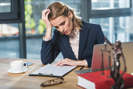 portrait of tired lawyer doing paperwork at workplace in office Zdjęcie Seryjne