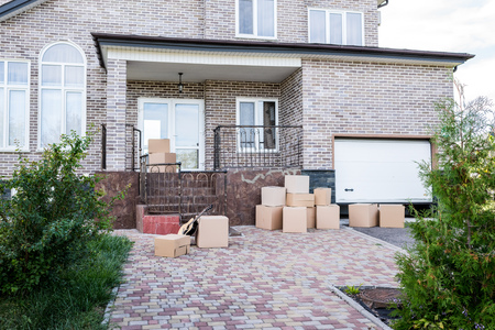 modern house with stacks of cardboard boxes for moving