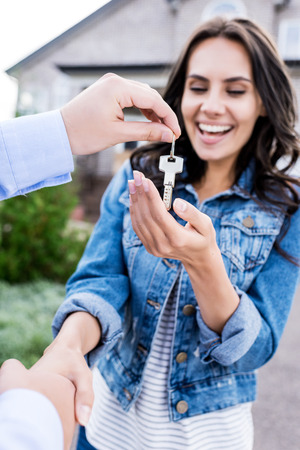 close-up shot of woman buying new house and shaking hands with realtor