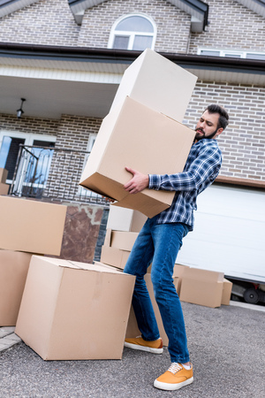 young man moving into new house Stock Photo