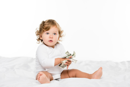 portrait of cute toddler holding money in hands isolated on white