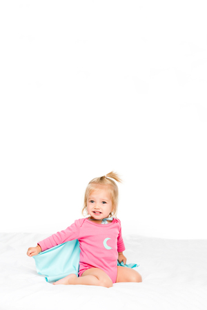 cute baby in superhero cape and bodysuit isolated on white