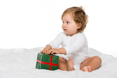 adorable toddler girl with wrapped present isolated on white