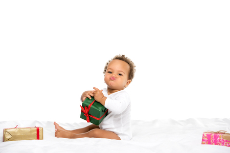 adorable african american toddler boy with wrapped gifts isolated on white Stock Photo