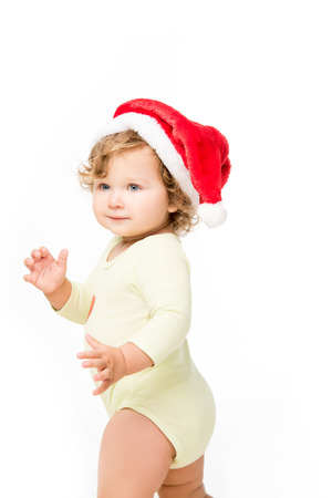 portrait of beautiful toddler girl in santa hat looking away isolated on white Stock Photo