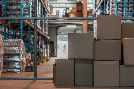 cardboard boxes in modern storehouse interior  Stock Photo