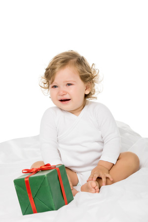 crying toddler girl with wrapped present isolated on white
